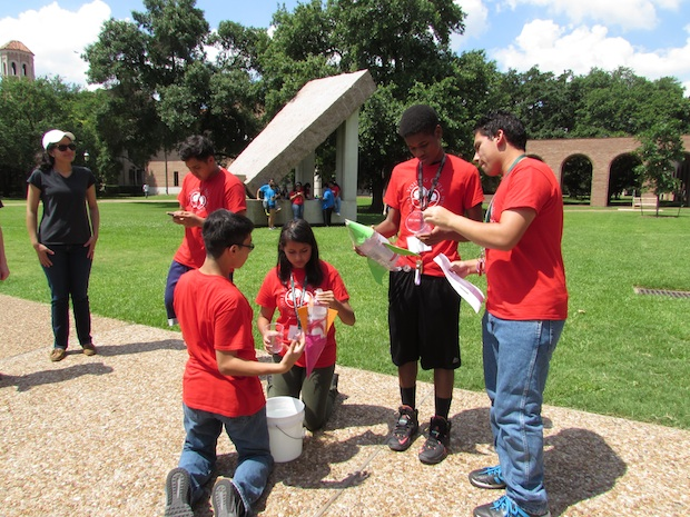 Participants in the Young Owl Leadership Program test an invention in the Engineering Quad.