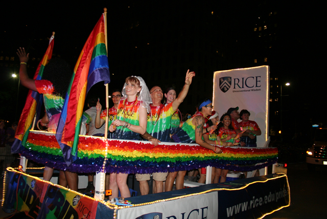 Students wear tie-dyed T-shirts on Rice's float in the pride parade.