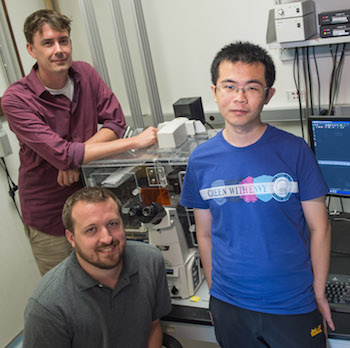 Rice University researchers, from left, synthetic biologist Matthew Bennett and graduate students Andrew Hirning and Ye Chen, have created multicellular circuits by programming bacteria to alter gene expression in an entire population.