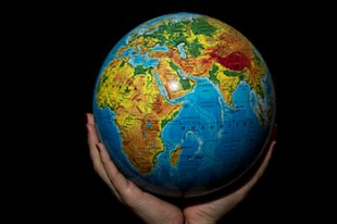 image of globe held in two hands