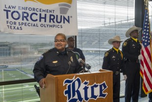 Johnny Whitehead at lectern for news conference about Law Enforcement Torch Run for Special Olympics Texas