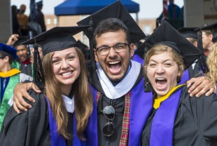 Three students excited after graduating