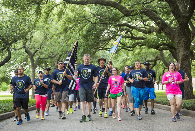 Law enforcement officers from Houston and the Gulf Coast area run along Loop Road for the first leg of the Law Enforcement Torch Run for Special Olympics Texas.