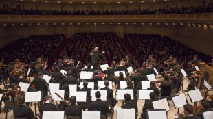 Larry Rachleff directs the Shepherd School symphony orchestra during its 2014 Carnegie Hall debut. Photo credit: Jennifer Taylor.