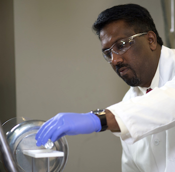 Paul Cherukuri prepares a Teslaphoresis experiment at Rice.