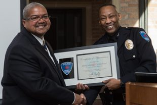 Rice Chief of Police Johnny Whitehead (left) received a certificate of appreciation from Jim Tate, chief of university police at the University of St. Thomas.