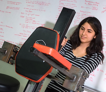 Rice University freshman Isabel Gonzalez adjusts a setting on the Castaway team's device to make long fitting sessions more comfortable for patients being fitted for a prosthetic leg.