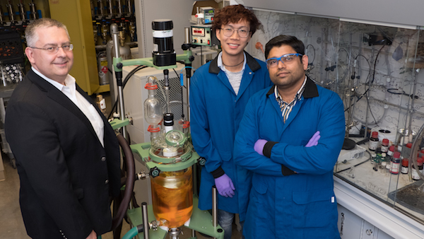 Rice University researchers, from left, László Kürti, Surached Siriwongsup and Padmanabha Kattamuri stand by the custom reactor they use to produce a nitrogen polarity-reversal agent in bulk. The aminating agents derived from it are meant to simplify the process by which chemists design drugs and other compounds.