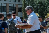 Head football coach David Bailiff shared pizza and team spirit with students at Willy's Statue. (Photo by Jeff Fitlow)