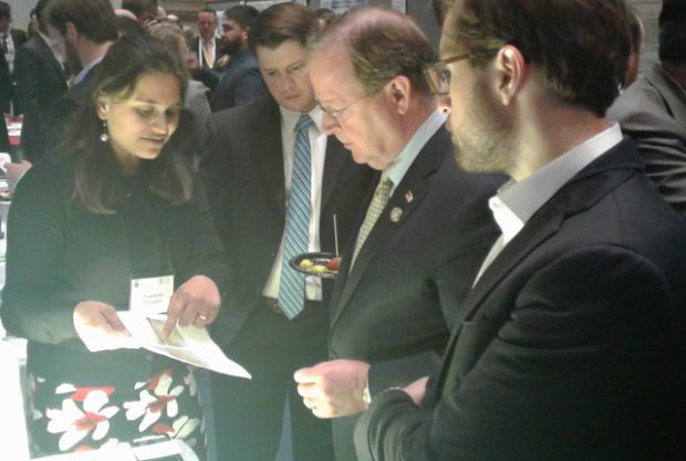 Graduate student Pratiksha Dongare explains her solar water desalination project to U.S. Rep. Bill Flores, R-Texas, at the University Innovation and Entrepreneurship Showcase in Washington, D.C..