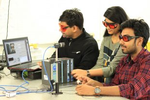 Rice University graduate students (from left) Mayank Kumar, Amruta Pai and Akash Maity performing tests.