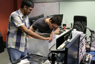 Surya Paruchuri and Lev Shuhatovich assemble a massive MIMO base station