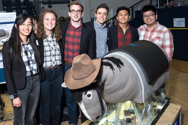 Rice University students presented their version of a mechanical horse for hippotherapy at the George R. Brown Engineering Design Showcase, where they won an Excellence in Capstone Engineering Design Award. From left: Jijie Zhou, Kelsi Wicker, James Phillips, Matthew O'Gorman, Wesley Yee and Sebastian Jia. (Credit: Jeff Fitlow/Rice University)