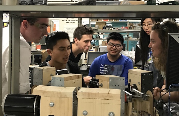 Rice University students who developed a mechanical hippotherapy horse work out the details of their Stewart platform-based mechanism at the Oshman Engineering Design Kitchen on campus. From left: James Phillips, Wesley Yee, Matthew O'Gorman, Sebastian Jia, Jijie Zhou and Kelsi Wicker. (Credit: Rice University)