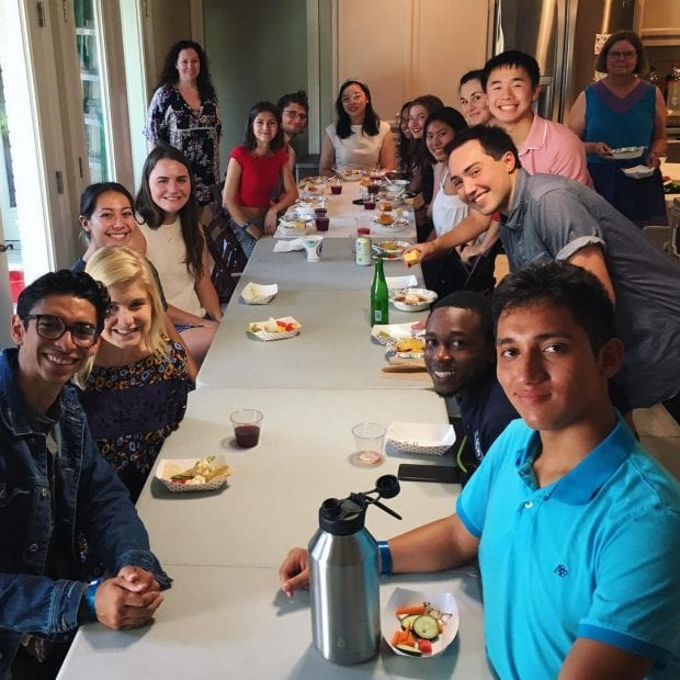 Baker College students enjoy a home-cooked meal. (Photo by Bryan Najera Demoraes)
