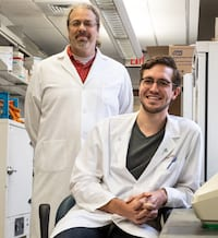 Rice synthetic biologist Joff Silberg, left, graduate student Josh Atkinson and their colleagues have developed protein switches that can be used to control the flow of electrons within cells. The synthetic proteins are one of the few remaining components needed to mimic entire electronic devices within cells. (Credit: Jeff Fitlow/Rice University)