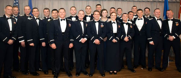 Three Rice alumni, all of whom earned master's degrees in the lab of Professor Tayfun Tezduyar, are among the most recent graduates of the Air Force Test Pilot School. Pictured with their fellow classmates are Capt. Darren Montes '12, fourth from left; Capt. Ryan Kolesar '14, 12th from left; and Maj. Samuel Wright '10, fifth from right. Photo by Joe Jones/U.S. Air Force