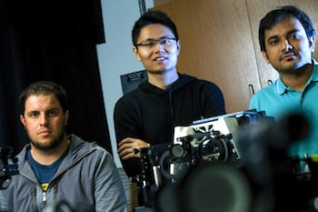 Rice University researchers, from left, Nicholas Moringo, Fan Ye and Chayan Dutta are co-authors of a new paper that advances super temporal resolution microscopy, a technique the lab has advanced with the ability to make custom phase masks. Photo by Jeff Fitlow