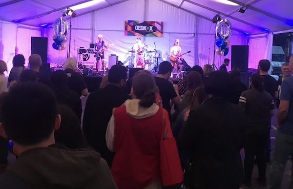 A crowd grooves to the Spazmatics in the large tent outside the OEDK.