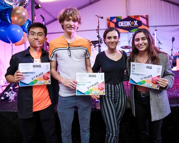 "Winners of the OEDK engineering art competition, from left: Scout Kan for ""Gears of Inspiration,"" third place; Braden Perryman and Maggie Webb for ""Natural Reflections,"" second place, and Fernanda Lago for ""Generating an Idea,"" first place. Photo by An Le"