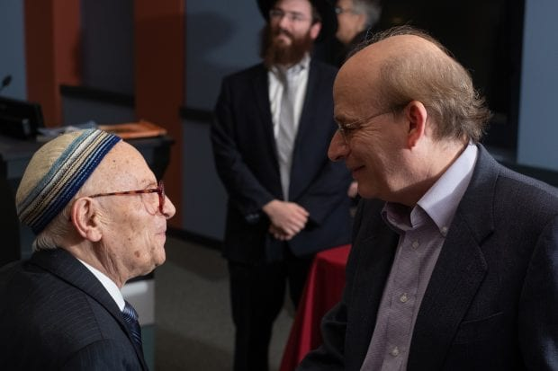 Rice president David Leebron greets Jacob Eisenbach as Rabbi Shmuli Slonim looks on.