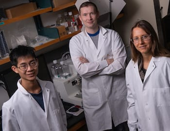 Rice University researchers (from left) Ryan Lee, Alexey Revtovich and Natasha Kirienko showed how a dietary deficit of vitamin B12 harms the health of nematodes at a cellular level, leading to an increased risk of infection by two potentially deadly pathogens. (Photo by Jeff Fitlow/Rice University)