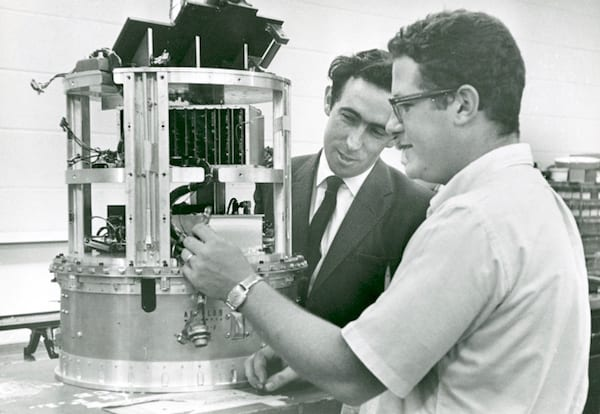Professor Brian O'Brien, left, and Rice alumnus David Reasoner, by then a Rice space scientist himself, work on a space-bound probe in 1966. Photo courtesy of Fondren Library/Rice University