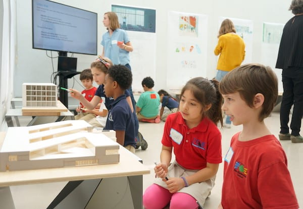 Poe Elementary students view a model of an elementary school by graduate students at the Rice School of Architecture during a recent visit.