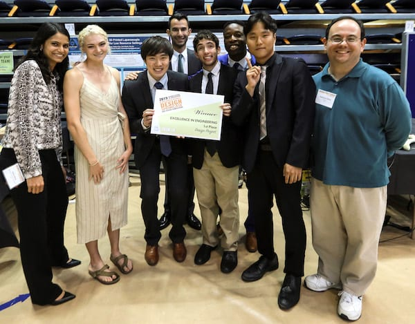 Drill Team Six won the top prize in the Brown School of Engineering Design Showcase. From left, adviser and bioengineering lecturer Sabia Abidi, Hannah Jackson, Takanori Iida, Will Yarinsky, Ian Frankel, Babs Ogunbanwo, Byung-UK Kang and Matthew Elliott, a lecturer in mechanical engineering. Photo by An Le/Luxe Studio Productions