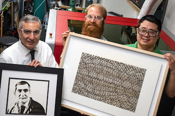 "Imaging with laser-induced graphene (LIG) was taken to a new level in a Rice University lab. From left, chemist James Tour, holding a portrait of himself in LIG; artist Joseph Cohen, holding his work ""Where Do I Stand?""; and Yieu Chyan, a Rice graduate student and lead author of a new paper detailing the process used to create the art. (Credit: Jeff Fitlow/Rice University)"