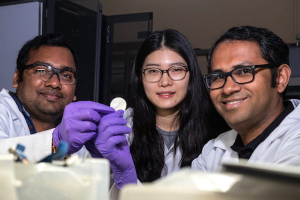 From left, postdoctoral researcher Anand Puthirath, academic visitor Fanshu Yuan and research scientist M.M. Rahman show the high-temperature flexible dielectric material invented at Rice University. The three are among authors of a paper in Advanced Functional Materials that details the work. (Credit: Jeff Fitlow/Rice University)