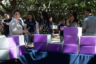 Kate Cross, associate dean of graduate and postdoctoral studies, shook hands and greeted students as they hauled off their prize desserts.