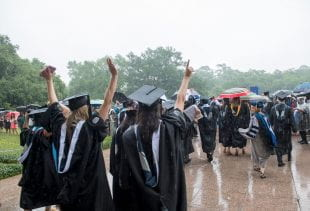 A little rain didn't dampen the spirits of the newly minted graduates as they made their ceremonial exit through the Sallyport. Photo by Tommy LaVergne.