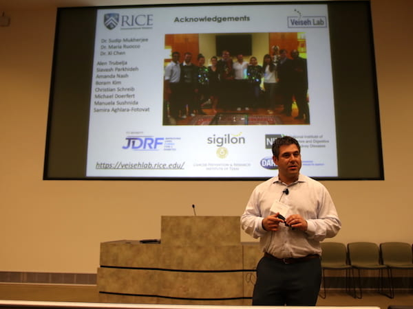 Omid Veiseh, an assistant professor of bioengineering, speaks to attendees at the Texas Biomaterials Day symposium. Photo by Christi Vasquez