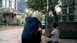 """""""I have never loved teaching like I love teaching now,"""" said Winningham, shown in the Fourth Ward during one of his photo strolls through Houston. (Photo by Brandon Martin)"""