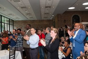 The Rice community filled the Cohen House to toast Marie Lynn Miranda June 28. (Photos by Jeff Fitlow)
