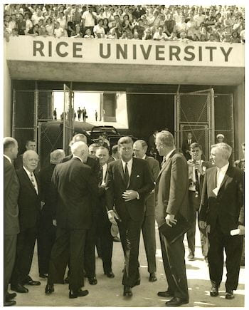 President Kennedy and Dr. Kenneth Pitzer enter Rice Stadium.