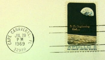 A cancelled stamp and postmark from the Curt Michel collection at Woodson mark the day of the first steps on the moon.
