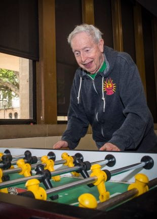 Doc C enjoying a game of foosball at Will Rice College. Photo by Tommy LaVergne.