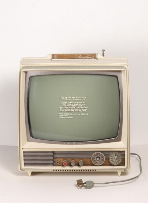 """Siah Armajani, """"Moon Landing,"""" 1969. Multimedia Sculpture using stenciled television, lock and ink on five sheets of newspaper. Television with stencil: 13 1/2 × 12 1/2 × 9"""" ( 34.3 × 31.8 × 22.9 cm)"""