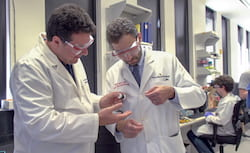 Rice University Professor Matteo Pasquali, left, and Dr. Mehdi Razavi of the Texas Heart Institute check a thread of carbon nanotube fiber invented in Pasquali's Rice lab. They are collaborating on a method to use the fibers as electrical bridges to restore conductivity to damaged hearts. (Credit: Texas Heart Institute)