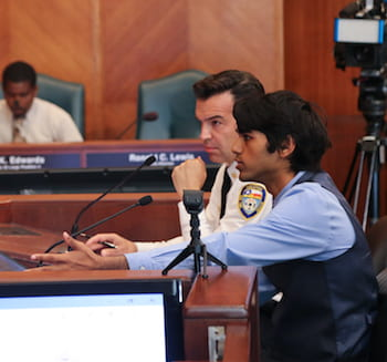 Ashwin Varma, right, makes his case before the Houston City Council's Public Safety Committee on Aug. 13. With him at left is Assistant Fire Chief Ruy Lozano. Photo by Donald Soward