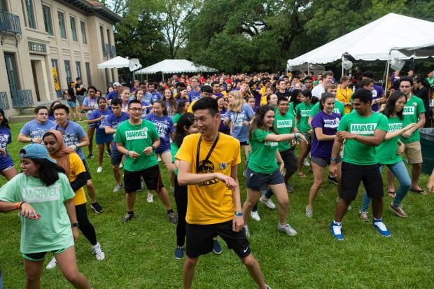 New freshmen enjoyed the traditional Texas pairing of line dancing and barbecue as President David Leebron and University Representative Y. Ping Sun, their dog Tex in tow, hosted the students at their home Aug. 19. (Photos by Jeff Fitlow)
