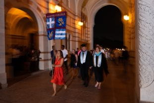 Martel College magisters Frank and Carrie Toffoletto led their new students through the Sallyport during matriculation. (Photo by Jeff Fitlow)