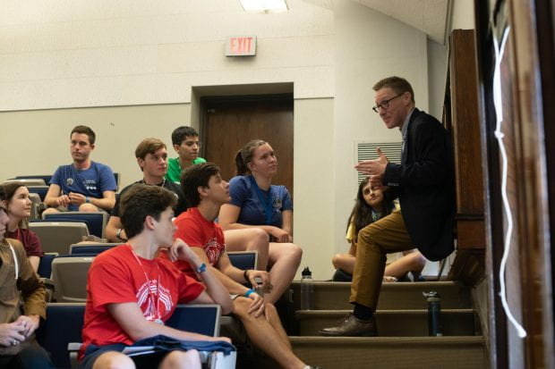 Caleb McDaniel, Duncan College magister and associate professor of history, chatted with freshmen following an Aug. 19 orientation session for the School of Humanities.