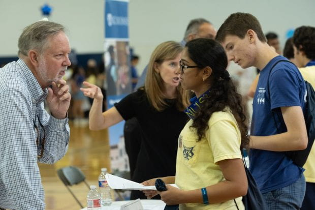 Keith Cooper, '78, the L. John and Ann H. Doerr Chair in Computational Engineering and former chief marshal for commencement, talks shop with Florida freshman Leigh Gabriely during the Academic Fair Aug. 20.