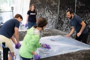 Rice students working at the Moody Center for the Arts helped Harold Mendez install his new piece in Brochstein Pavilion. (Photos by Jeff Fitlow)