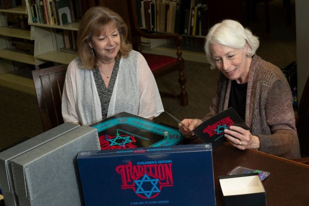 "Estelle Panzer and Janis Odensky, two of the three Houston women responsible for creating the ""Jewish version of Trivial Pursuit"" in the 1980s, stopped by the Woodson Research Center in Fondren Library Aug. 30 to donate original adult and children's versions of the board game, newspaper clippings and more to the Houston Jewish History Archive."