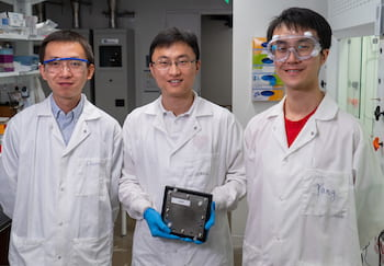 Rice University researchers – from left, Chuan Xia, Haotian Wang and Yang Xia – show a scaled-up hydrogen peroxide reactor that makes the valuable chemical using just air, water and electricity. Their work appears in the journal Science. (Credit: Brandon Martin/Rice University)