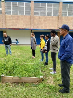 The team visited Attucks Middle School to observe how the students are taught to use aquaponics to grow plants. This system became the model for the Sunnyside Energy Project's Aquaponics Hub.